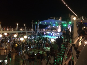 Tesla on pool stage for sail away - MOR Cruise 2015